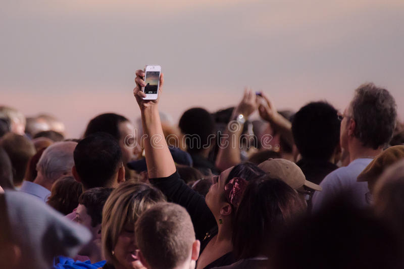 Crowd taking pictures with cell phones, event. royalty free stock photos