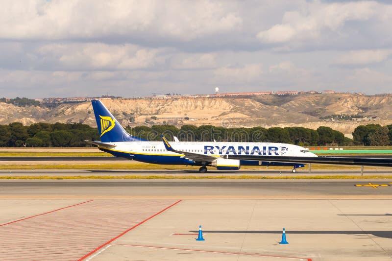 Barajas International Airport, Madrid. MADRID, SPAIN - FEB 12, 2015: Ryanair in the Adolfo Suarez Madrid Barajas Airport. Barajas is the main international stock photography