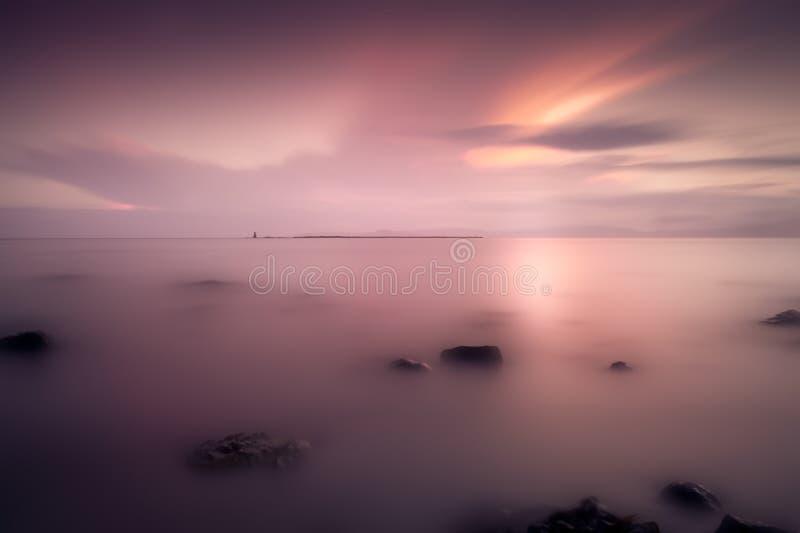 Barassie brzeg Troon w Ayrshire Szkocja z czerwonym zmierzchu niebem na lato nocy zdjęcia royalty free