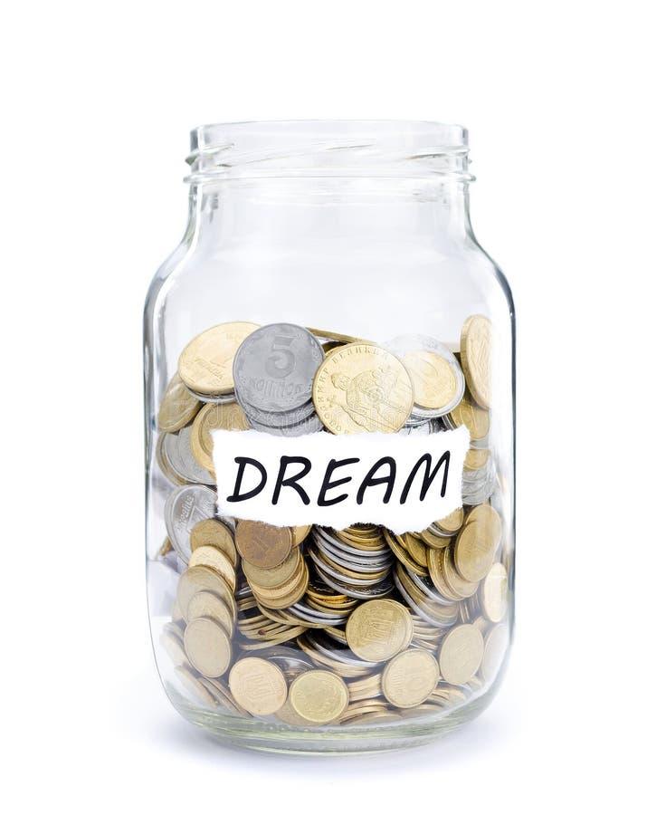 Barattolo con le monete sul sogno fotografie stock libere da diritti