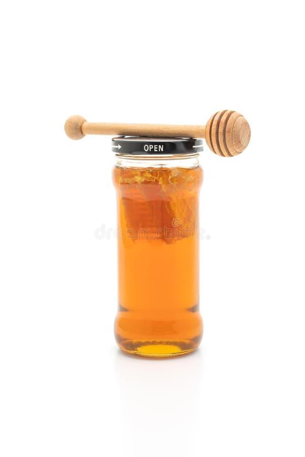 Barattolo del miele su fondo bianco fotografie stock
