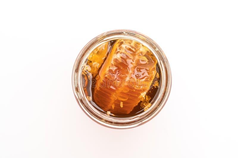 Barattolo del miele su fondo bianco fotografia stock