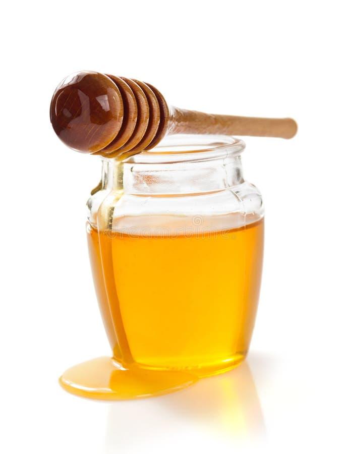 Barattolo di miele su fondo bianco fotografia stock libera da diritti