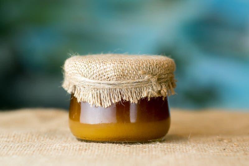 Barattolo di vetro del miele immagini stock