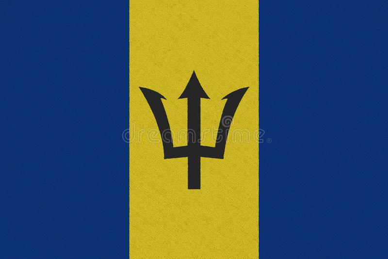 Barbados fabric flag. Patriotic background. National flag of Barbados stock images