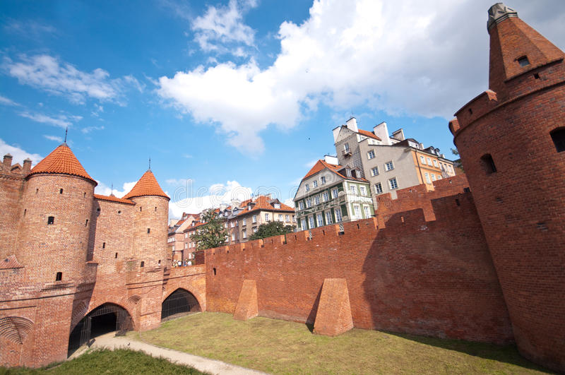 Barbakan, Warsaw, Poland. Wide angle image of famous round towers of Barbakan (Barbican) stronghold, Warsaw, Poland stock images