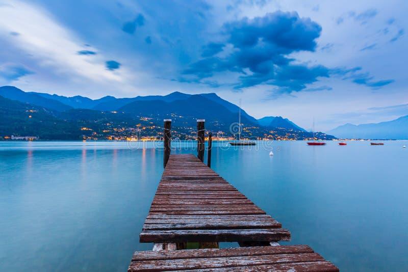 Barbarano di Salo, Italy, at Lake Garda during a beautiful sunset. Barbarano di Salo, Italy, beautiful sunset above water at Lake Garda royalty free stock images