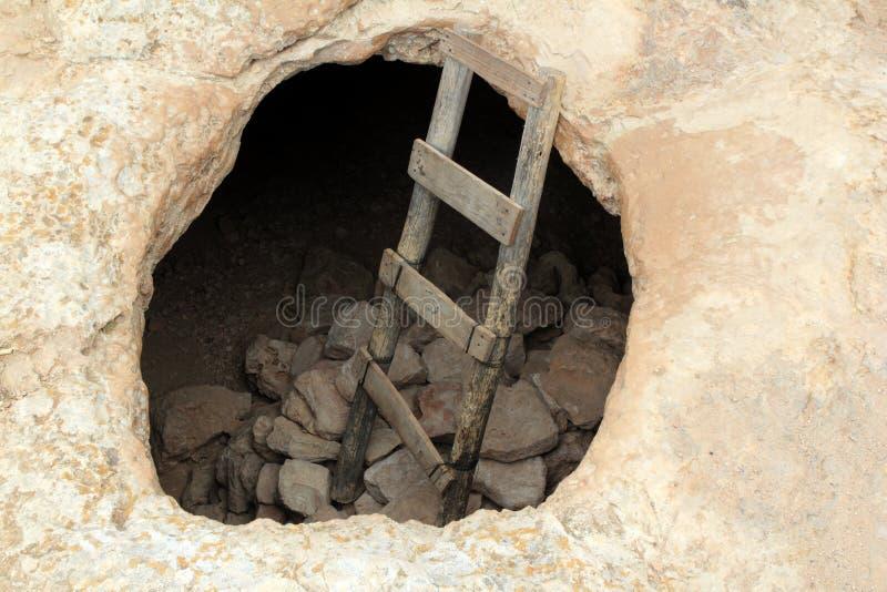 Barbaria cape cave hole aged wood steps. Magic Formentera island Balearic stock image