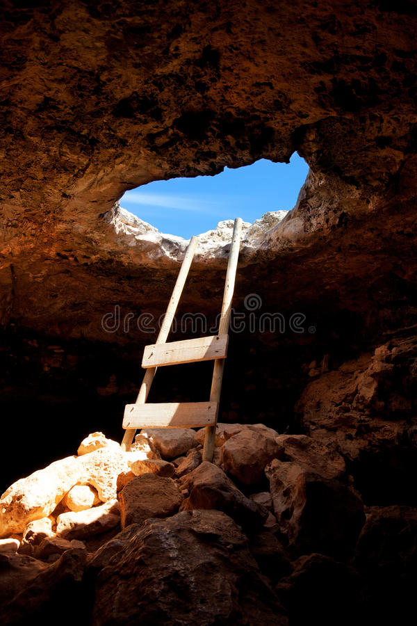 Barbaria cape cave hole with rustic ladder on wood royalty free stock photography