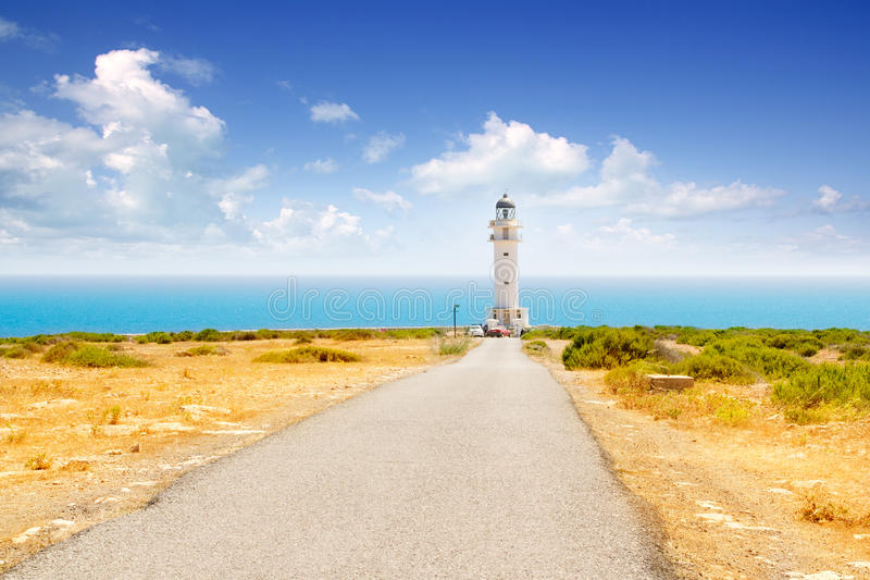 Barbaria cape lighthouse in Formentera. With road perspective royalty free stock photography