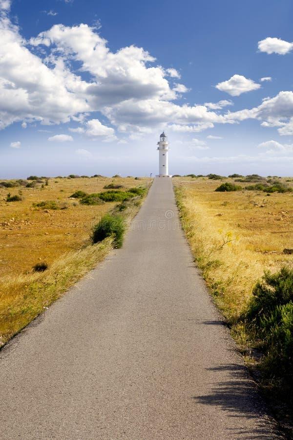 Barbaria cape lighthouse Formentera meadow stock photo