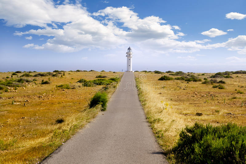 Barbaria cape lighthouse Formentera meadow. Barbaria berberia cape Formentera lighthouse golden meadow blue sky royalty free stock image