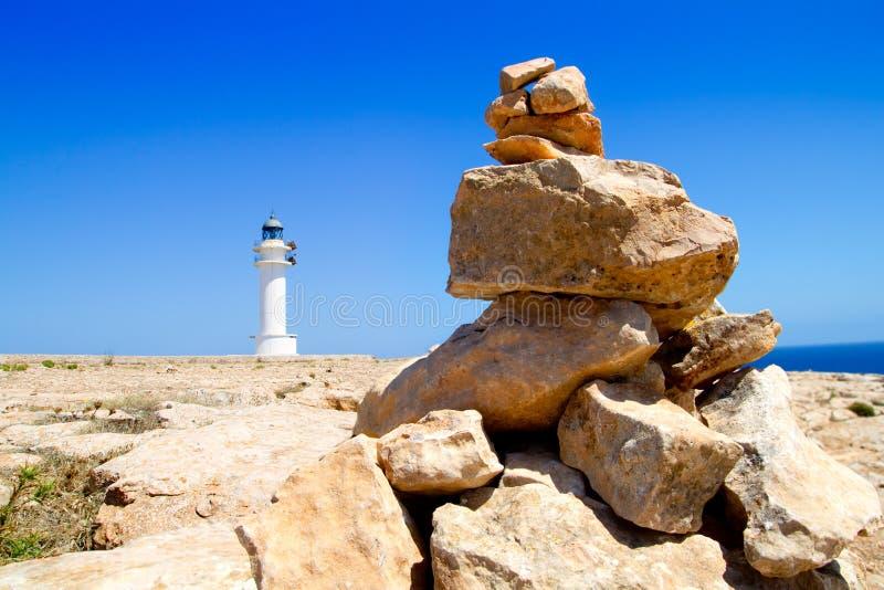 Barbaria formentera灯塔做愿望石头 库存照片
