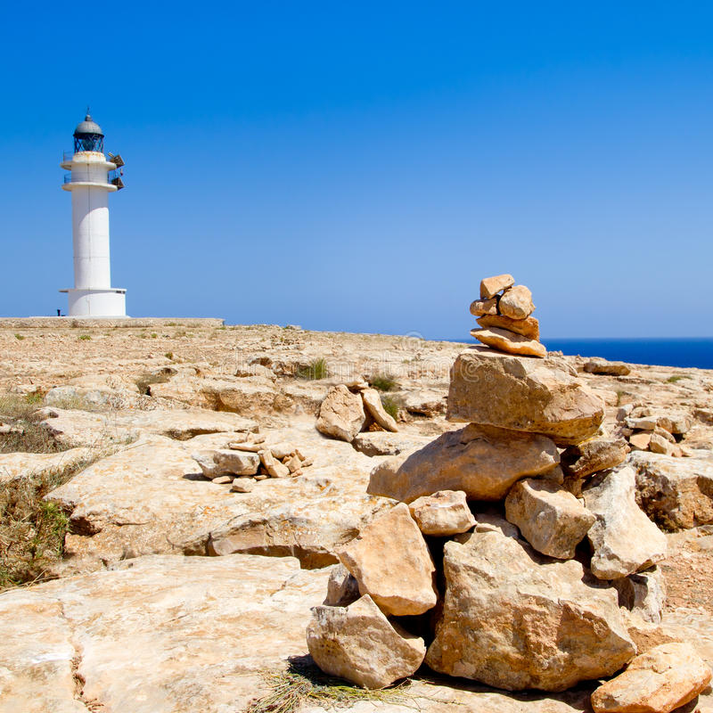 Barbaria formentera Lighthouse make a wish stones. Barbaria formentera Lighthouse and make a wish stones mound royalty free stock images