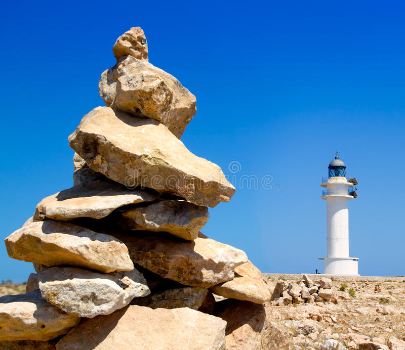 Barbaria formentera Lighthouse make a wish stones. Barbaria formentera Lighthouse and make a wish stones mound stock images