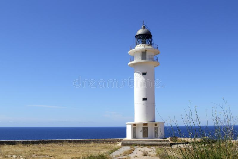 Barbaria lighthouse formentera Balearic islands. Blue sunny mediterranean day royalty free stock images
