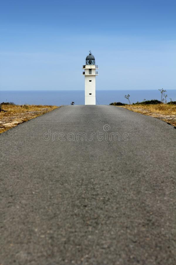 Barbaria lighthouse Formentera from road. Perspective Balearic Islands stock image