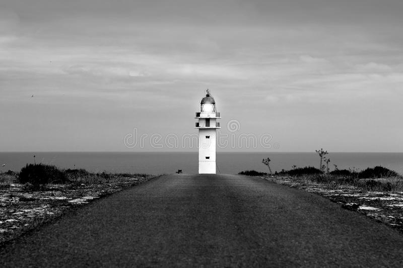 Barbaria lighthouse Formentera from road. Perspective Balearic Islands royalty free stock image