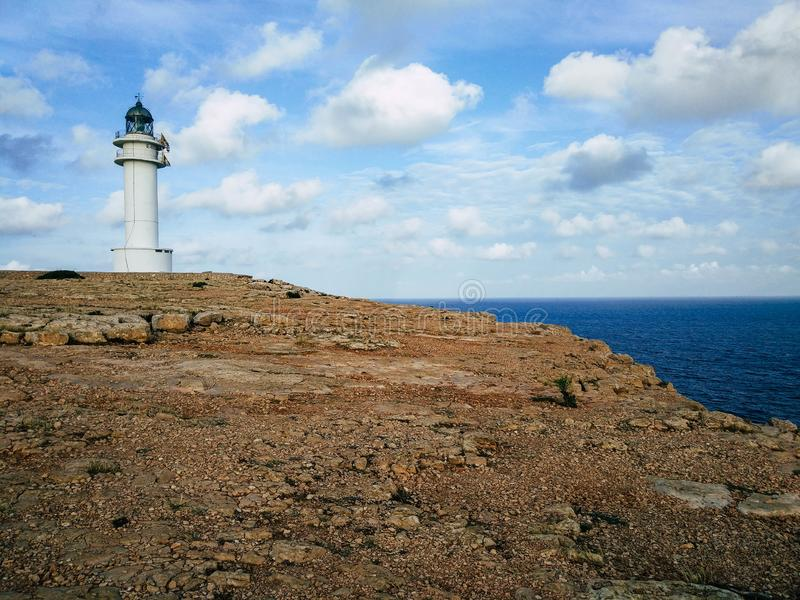 Barbaria Lighthouse at the top of a cliff stock photography