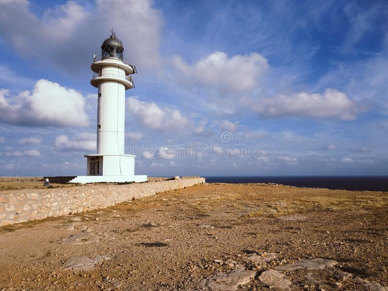 Barbaria Lighthouse at the top of a cliff royalty free stock image