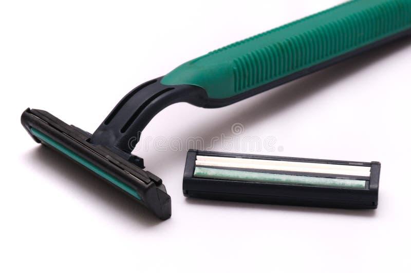 Barbeador e lâmina descartáveis verdes da segurança imagens de stock royalty free