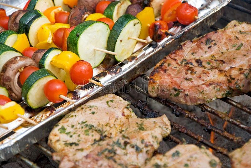 Barbecue. Steaks and vegetables on the grill for barbecue royalty free stock photography