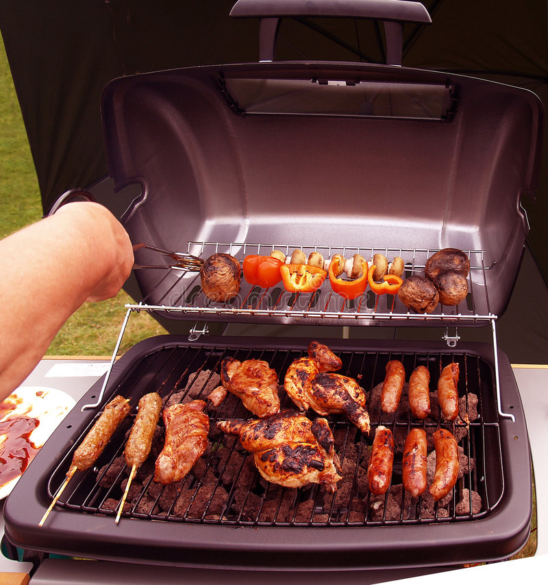 Barbecue. Outside with a wind break sign of summer royalty free stock photos