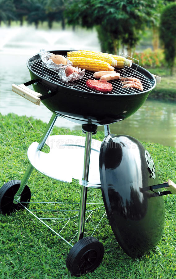 Barbecue. Grilled meat barbecue at garden royalty free stock photo