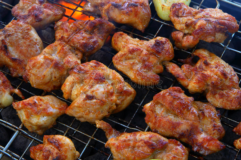 Barbecue. Chicken barbecue on the fire royalty free stock image