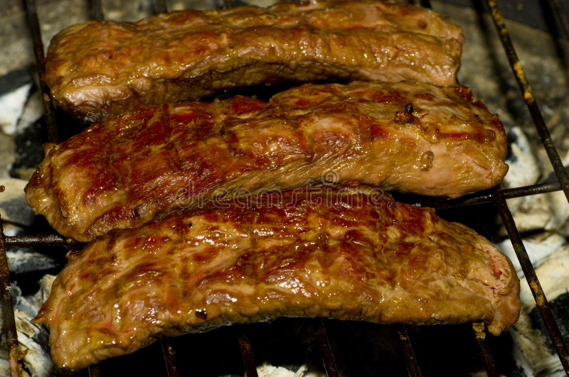 Barbecue. Delicious grilled lamb filet meat on a BBQ stock image