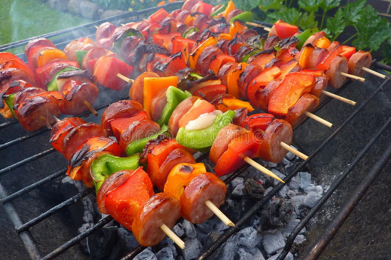 Barbecue. Backyard barbecue with meat and fresh vegetables, grill royalty free stock images