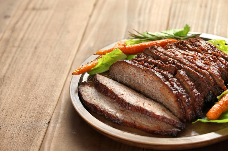 Barbecue beef brisket. Isolated on brown wood royalty free stock photos