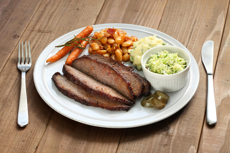 Barbecue beef brisket plate. Barbecue beef brisket, texas style royalty free stock image