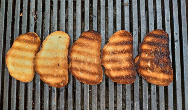 Barbecue bread on the grill. Delicious fried bread for toast. Street food stock photography