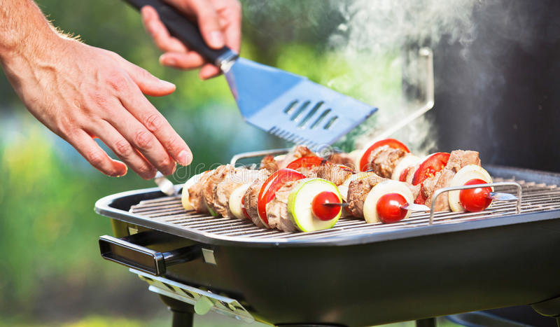 Barbecue Camping. Cooking meat on grill outdoors stock photos