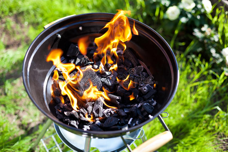 Barbecue charcoal in fire, preparing for grilling stock photos