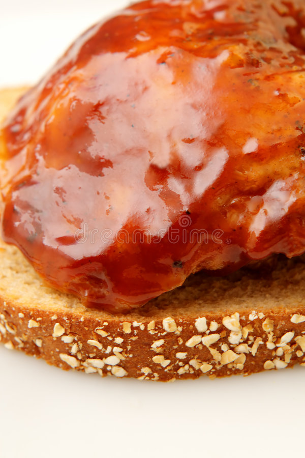 Barbecue chicken. On wheat bread stock photography