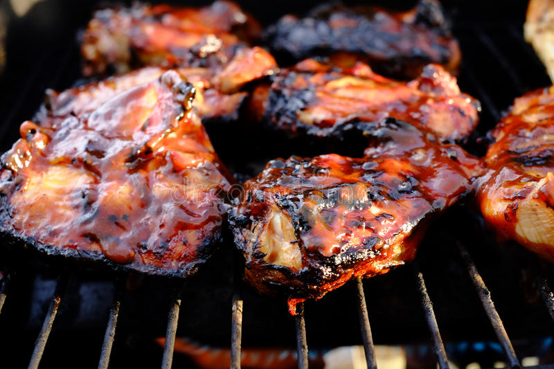 Barbecue chicken on grill stock photos