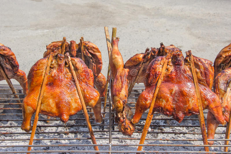 Barbecue chicken on grill stove in Thai restaurant,outdoors stock photo
