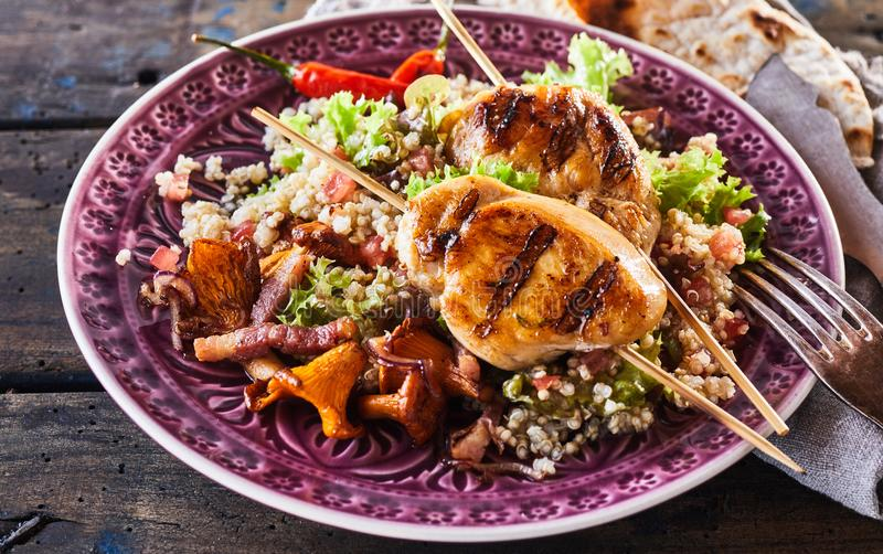 Barbecue chicken skewer dish with quinoa close up royalty free stock photos