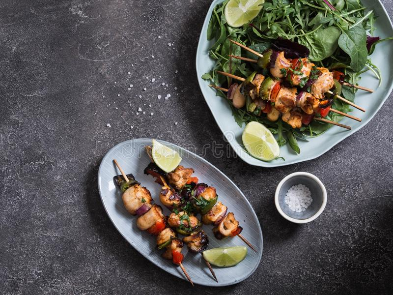 Barbecue of chicken on skewers with vegetables and lives stock photo