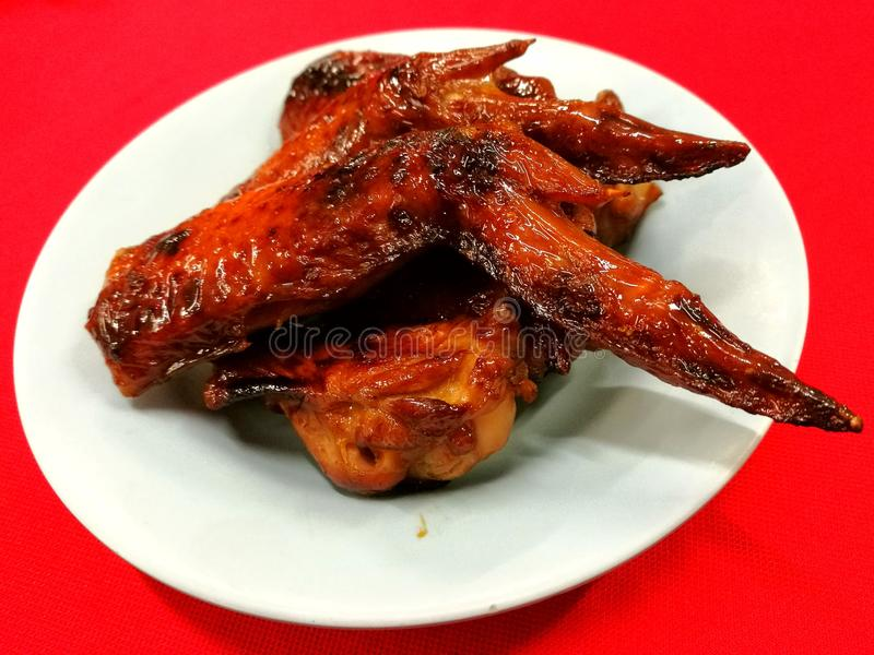 Barbecue Chicken Wing. Sweet and smoky barbecue wings, an oriental favorite in any ocassion royalty free stock images