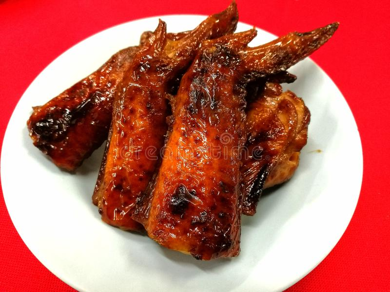 Barbecue Chicken Wing. Sweet and smoky barbecue wings, an oriental favorite in any ocassion stock images