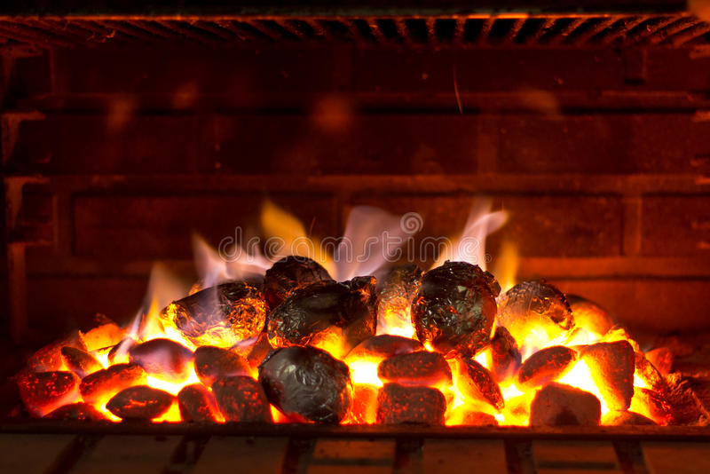 Barbecue Cooking. Potatoes cooked on a barbecue at night royalty free stock photo