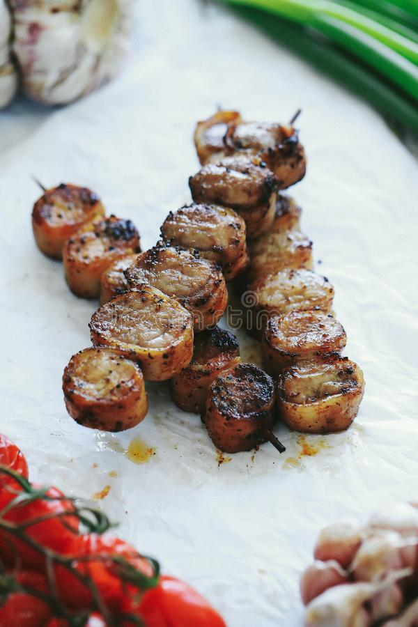 Barbecue. Cooking recipe. Delicious barbecue cooking method with tomatoes royalty free stock image