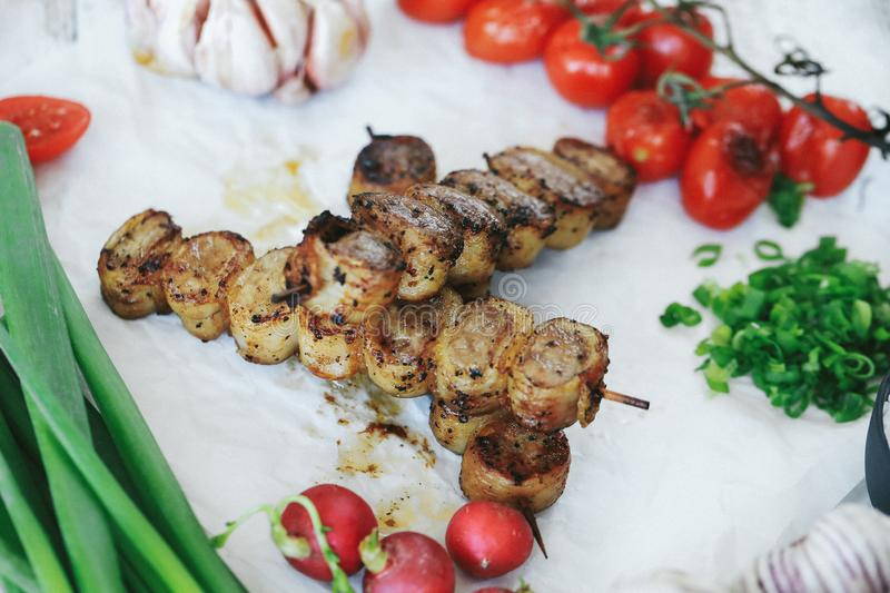 Barbecue. Cooking recipe. Delicious barbecue cooking method with tomatoes royalty free stock photo
