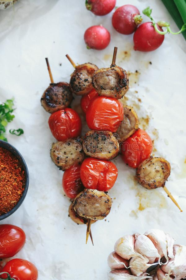Barbecue. Cooking recipe. Delicious barbecue cooking method with tomatoes stock image
