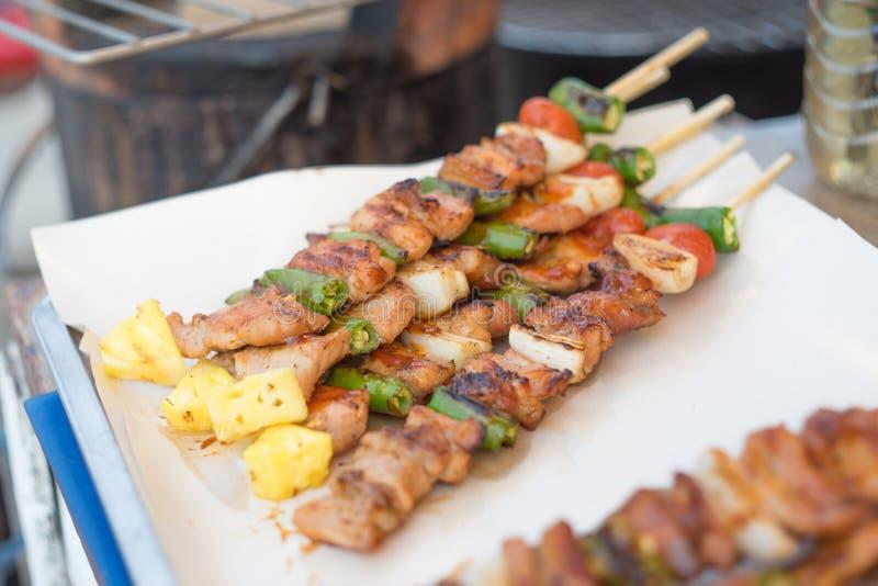 Barbecue et rôti de porc photographie stock libre de droits