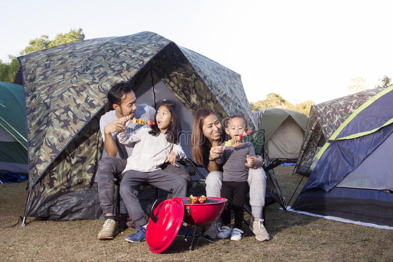Barbecue and family on camping. In nature stock photography