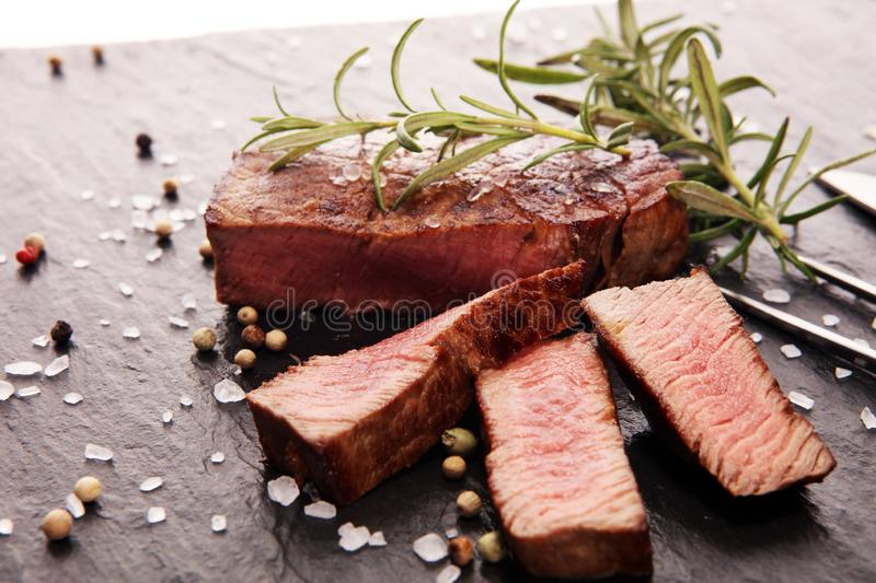 Barbecue filet Steak. Black Angus Prime meat steaks. Tenderloin fillet mignon royalty free stock photo